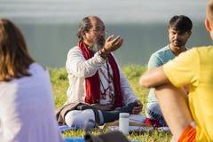 Tibetan Lama conducts classes with sunsurfers people on meditation and yoga. Pokhara, Nepal Stock Photo