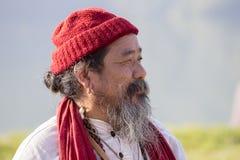 Tibetan Lama conducts classes with sunsurfers people on meditation and yoga. Pokhara, Nepal Royalty Free Stock Photography
