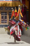Tibetan lama dressed in mask dancing Tsam mystery dance on Buddhist festival at Hemis Gompa. Ladakh, North India Stock Photography