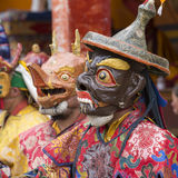 Tibetan lama dressed in mask dancing Tsam mystery dance on Buddhist festival at Hemis Gompa. Ladakh, North India Royalty Free Stock Images