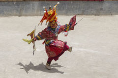 Tibetan lama dressed in mask dancing Tsam mystery dance on Buddhist festival at Hemis Gompa. Ladakh, North India Stock Photo