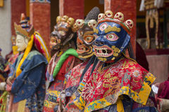 Tibetan lama dressed in mask dancing Tsam mystery dance on Buddhist festival at Hemis Gompa. Ladakh, North India. LAMAYURU, INDIA - JUNE 13, 2015: An Stock Images