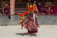 Tibetan lama dressed in mask dancing Tsam mystery dance on Buddhist festival at Hemis Gompa. Ladakh, North India. LAMAYURU, INDIA - JUNE 13, 2015: An Royalty Free Stock Photography