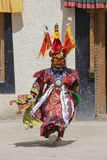 Tibetan lama dressed in mask dancing Tsam mystery dance on Buddhist festival at Hemis Gompa. Ladakh, North India. LAMAYURU, INDIA - JUNE 13, 2015: An Royalty Free Stock Image