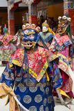 Tibetan lama dressed in mask dancing Tsam mystery dance on Buddhist festival at Hemis Gompa. Ladakh, North India Royalty Free Stock Image