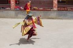 Tibetan lama dressed in mask dancing Tsam mystery dance on Buddhist festival at Hemis Gompa. Ladakh, North India Stock Images