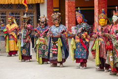 Tibetan lama dressed in mask dancing Tsam mystery dance on Buddhist festival at Hemis Gompa. Ladakh, North India. LAMAYURU, INDIA - JUNE 13, 2015: An Royalty Free Stock Images