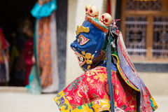 Tibetan lama dressed in mask dancing Tsam mystery dance on Buddhist festival at Hemis Gompa. Ladakh, North India. LAMAYURU, INDIA - JUNE 13, 2015: Unidentified Royalty Free Stock Photos