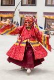 Tibetan lama dressed in mask dancing Tsam mystery dance on Buddhist festival at Hemis Gompa. Ladakh, North India Royalty Free Stock Photo