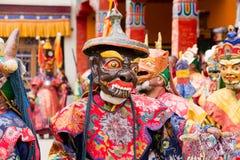 Tibetan lama dressed in mask dancing Tsam mystery dance on Buddhist festival at Hemis Gompa. Ladakh, North India Stock Photos
