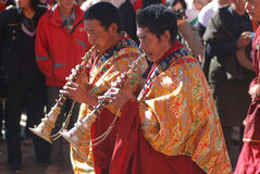 Tibetan lama festival. Two lamas blowing trumpet in a loacal buddist festival in a lamasery,Lhasa,Tibet,China Stock Image