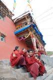 Tibetan lamas in an ancient Lamasery Stock Photos