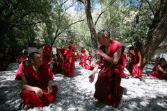 Tibetan Lamas Debating on Buddhist doctrines Stock Images