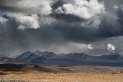 Tibetan landscape. With mountains and storm clouds Stock Images