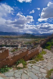 Tibetan landscape. Path in foreground and monastery buildings in background, Tibet, Asia Royalty Free Stock Photo