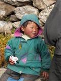 Tibetan Little Boy. Tibetan bashful little boy, holding in his hand a gift - a small polar bear stock photography
