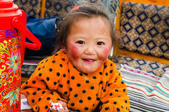 Tibetan little girl lives at the foot of Mount Kailash. Royalty Free Stock Images