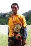 Tibetan man. Portrait of a Tibetan pilgrim while approaching Lhasa Stock Photography