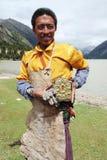 Tibetan man. Portrait of a Tibetan pilgrim while approaching Lhasa Stock Photo
