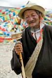 Tibetan Man. An elderly Tibetan man holding a buddhist prayer wheel royalty free stock images