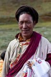 Tibetan man in Dolpo, Nepal. DHO TARAP, NEPAL - SEPTEMBER 11: An unidentified Tibetan man with lung-ta during the Dho Tarap Full Moon Festival on September 11 Stock Image
