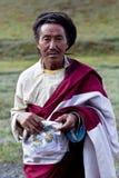 Tibetan man in Dolpo, Nepal. DHO TARAP, NEPAL - SEPTEMBER 11: An unidentified Tibetan man with ceremonial skarf during the Dho Tarap Full Moon Festival on Stock Images