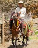 Tibetan Man on Horse. A Tibetan man in Tibet riding a horse. Taken July of 2012 Stock Photos