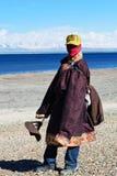 Tibetan man. NGARI PREFECTURE, TIBET - MAY 07: Tibetan pilgrim in national clothes walking around holy Manasarovar lake on May 07, 2013 in Tibet Autonomus Region Stock Photography