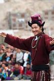 Tibetan man performing folk dance. India Stock Image