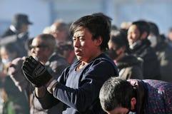 Tibetan man. Pilgrims in the Jokhang Temple in Lhasa Stock Photos
