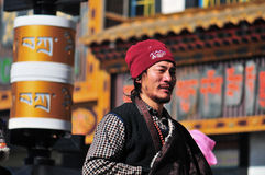 Tibetan man. Pilgrims in the Jokhang Temple in Lhasa Stock Photography