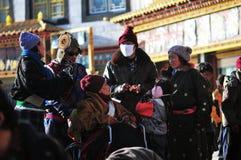 Tibetan man. Pilgrims in the Jokhang Temple in Lhasa Royalty Free Stock Photo