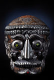 Tibetan man skull. Tibetan man decorated with a metal and crystal skull Stock Images