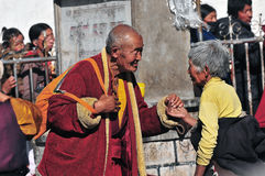 Tibetan man and women. Pilgrims in the Jokhang Temple in Lhasa Royalty Free Stock Images