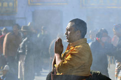 Tibetan man and women. Pilgrims in the Jokhang Temple in Lhasa Royalty Free Stock Photo