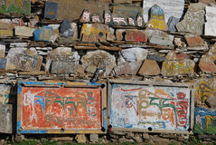Tibetan Mani stone. Wall in Kang area,or China's Sichuan province Stock Photos