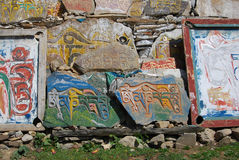 Tibetan Mani stone. Wall in Kang area,or China's Sichuan province Royalty Free Stock Photo