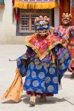 Tibetan men dressed in mask dancing Tsam mystery dance on Buddhist festival at Hemis Gompa. Ladakh, North India Stock Photo
