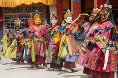 Tibetan men dressed in mask dancing Tsam mystery dance on Buddhist festival at Hemis Gompa. Ladakh, North India Royalty Free Stock Image