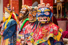 Tibetan men dressed in mask dancing Tsam mystery dance on Buddhist festival at Hemis Gompa. Ladakh, North India Royalty Free Stock Images