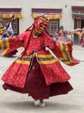 Tibetan men dressed in mask dancing Tsam mystery dance on Buddhist festival at Hemis Gompa. Ladakh, North India Stock Image