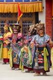 Tibetan men dressed in mask dancing Tsam mystery dance on Buddhist festival at Hemis Gompa. Ladakh, North India Royalty Free Stock Photo