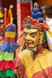 Tibetan men dressed in mask dancing Tsam mystery dance on Buddhist festival at Hemis Gompa. Ladakh, North India Royalty Free Stock Image