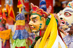 Tibetan men dressed in mask dancing Tsam mystery dance on Buddhist festival at Hemis Gompa. Ladakh, North India Stock Image