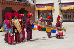 Tibetan men dressed mask dancing Tsam mystery dance on Buddhist festival at Hemis in Ladakh, North India Royalty Free Stock Photos