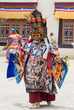 Tibetan men dressed mask dancing Tsam mystery dance on Buddhist festival at Hemis in Ladakh, North India Royalty Free Stock Images