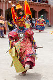 Tibetan men dressed mask dancing Tsam mystery dance on Buddhist festival at Hemis in Ladakh, North India Royalty Free Stock Photography