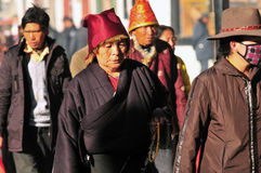 Tibetan men. Pilgrims in the Jokhang Temple in Lhasa stock images
