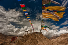 Tibetan monastery. Leh monastery surrounded by prayers flags in the middle of the mountains Royalty Free Stock Photos