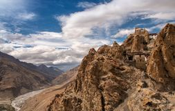 Tibetan Monastery perched on Mountain, Buddhist temple. Beautiful View of Dhankar Fort in Spiti Valley, Himachal Pradesh. India. On the left we can see the stock photo